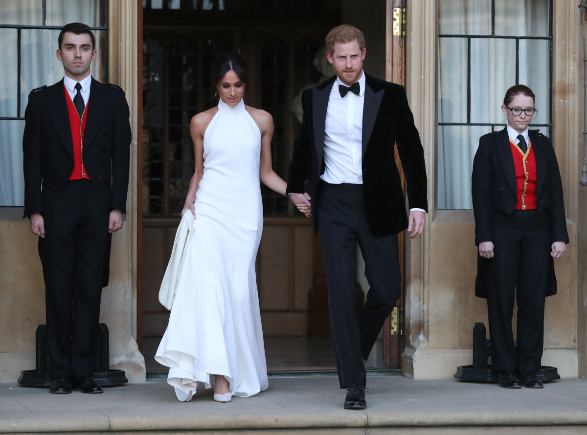 Meghan Markle in Stella McCartney and Prince Harry depart for their evening wedding reception. Photo: STEVE PARSONS/AFP/Getty Images