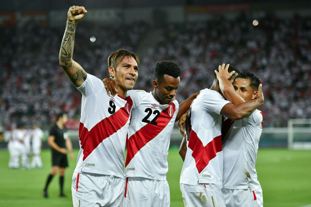 Peru's forward Paolo Guerrero (left) celebrates with teammates after scoring his team's third goal during a Saudi Arabia vs. Peru matchearlier this monthin Switzerland. Photo: Fabrice Coffrini/AFP/Getty Images