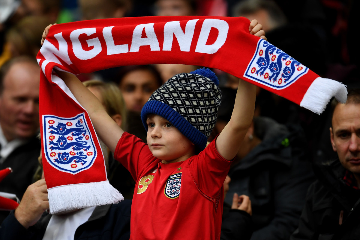A young England fan cheers on his team during a 2018 FIFA World Cup qualifier match in Oct. 2016 in London. Photo: Mike Hewitt/Getty Images