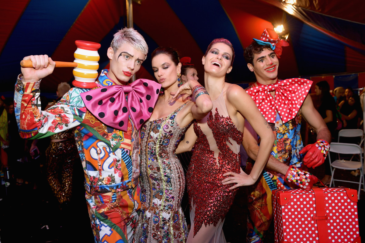 Models pose backstage at the Moschino Resort 2019 runway show. Photo: Matt Winkelmeyer/Getty Images