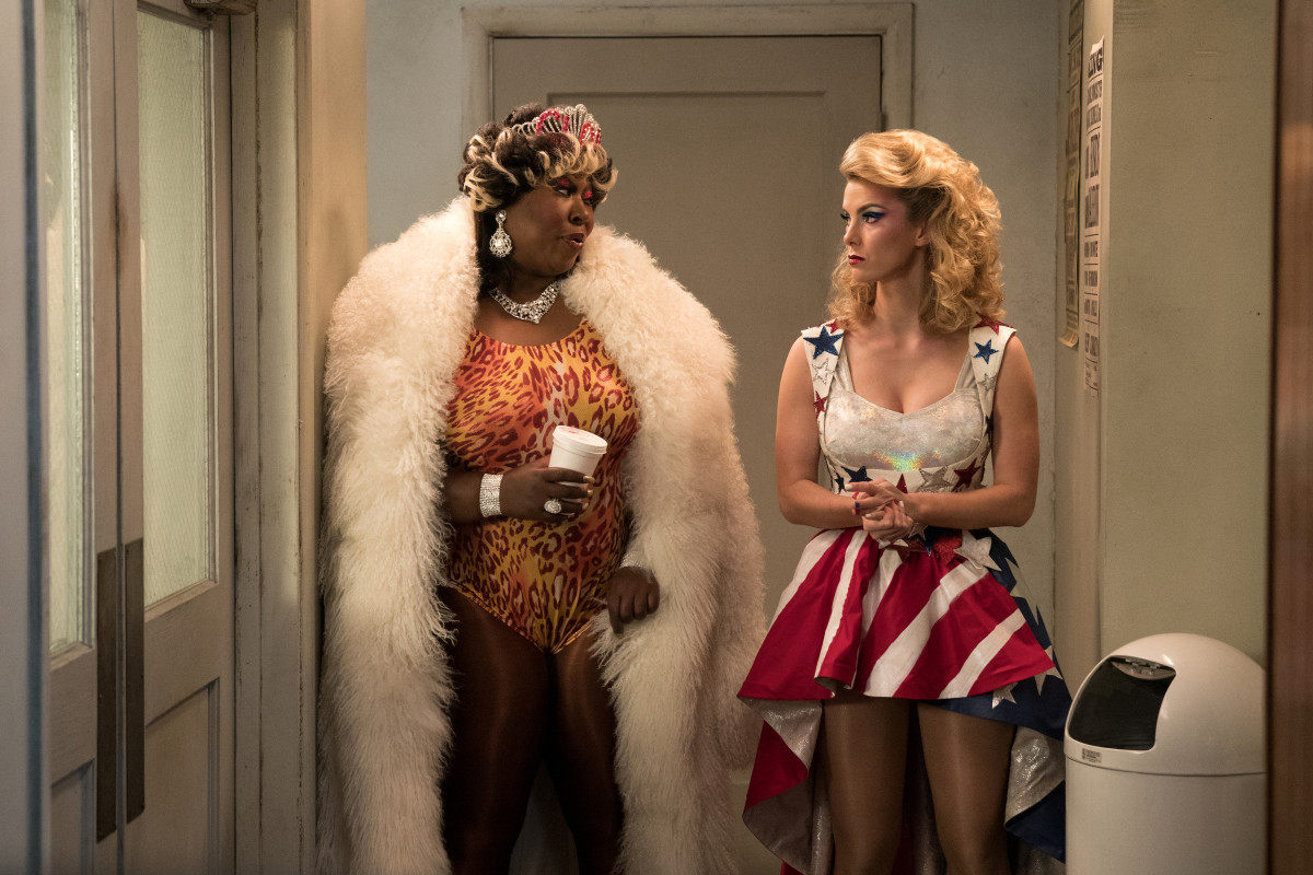 """Tammé wearing the coat she swiped from Bash's house in season one and Debbie debuting a new overskirt that Morgan wanted to use in season one. """"We had Jenny, story-wise, deconstruct [a pink pencil skirt from the mall] and use it as a specialty item in that match,"""" says Morgan. Photo:Erica Parise/Netflix"""