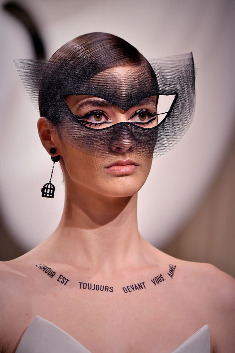 The cat-eye look Philips created in collaboration with milliner Stephen Jones. Photo: Pascal Le Segretain/Getty Images