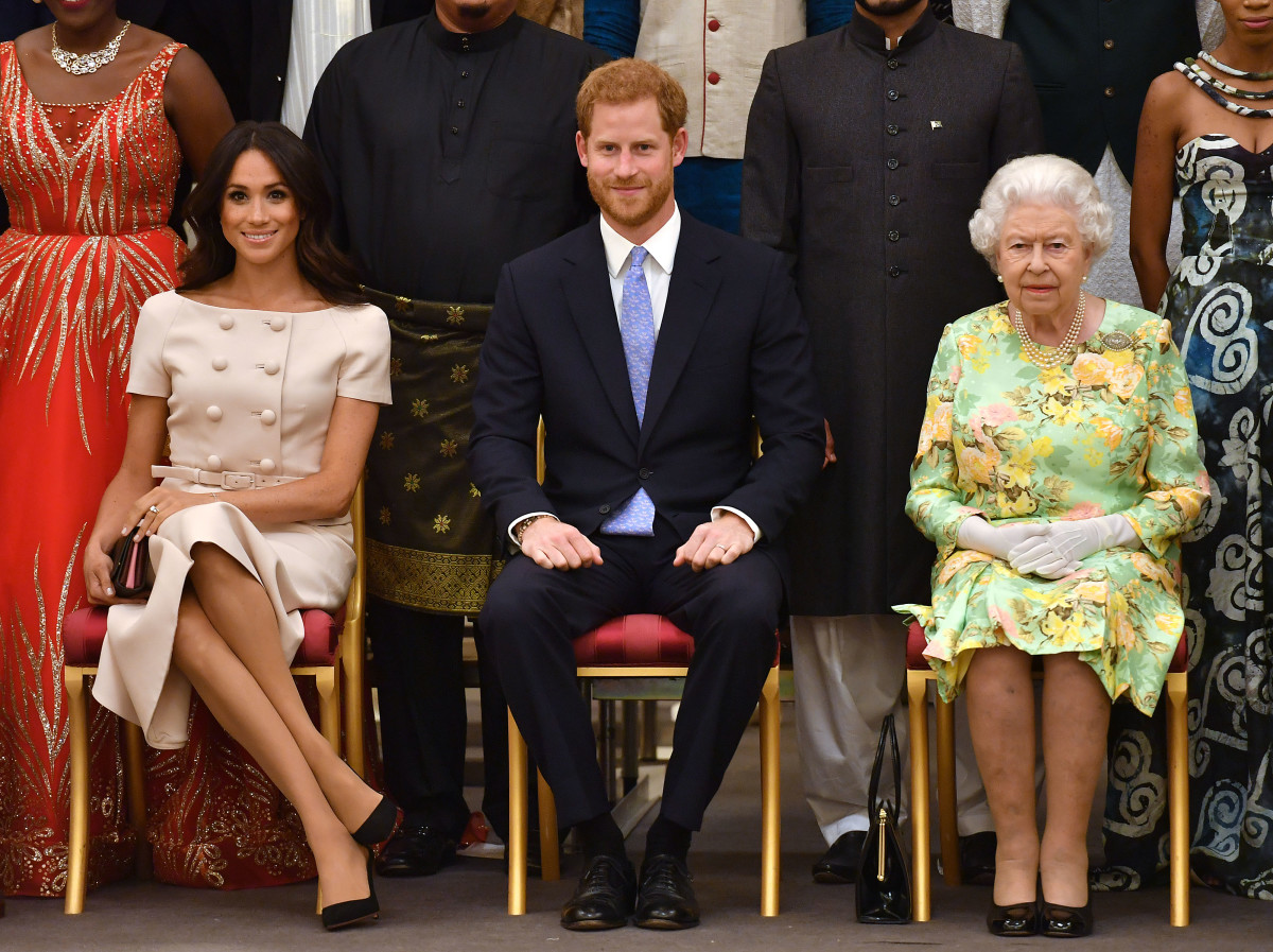 Meghan Markle, Duchess of Sussex, Prince Harry, Duke of Sussex and Queen Elizabeth II at the Queen's Young Leaders Awards Ceremony at Buckingham Palace in London, England. Photo:John Stillwell - WPA Pool/Getty Images