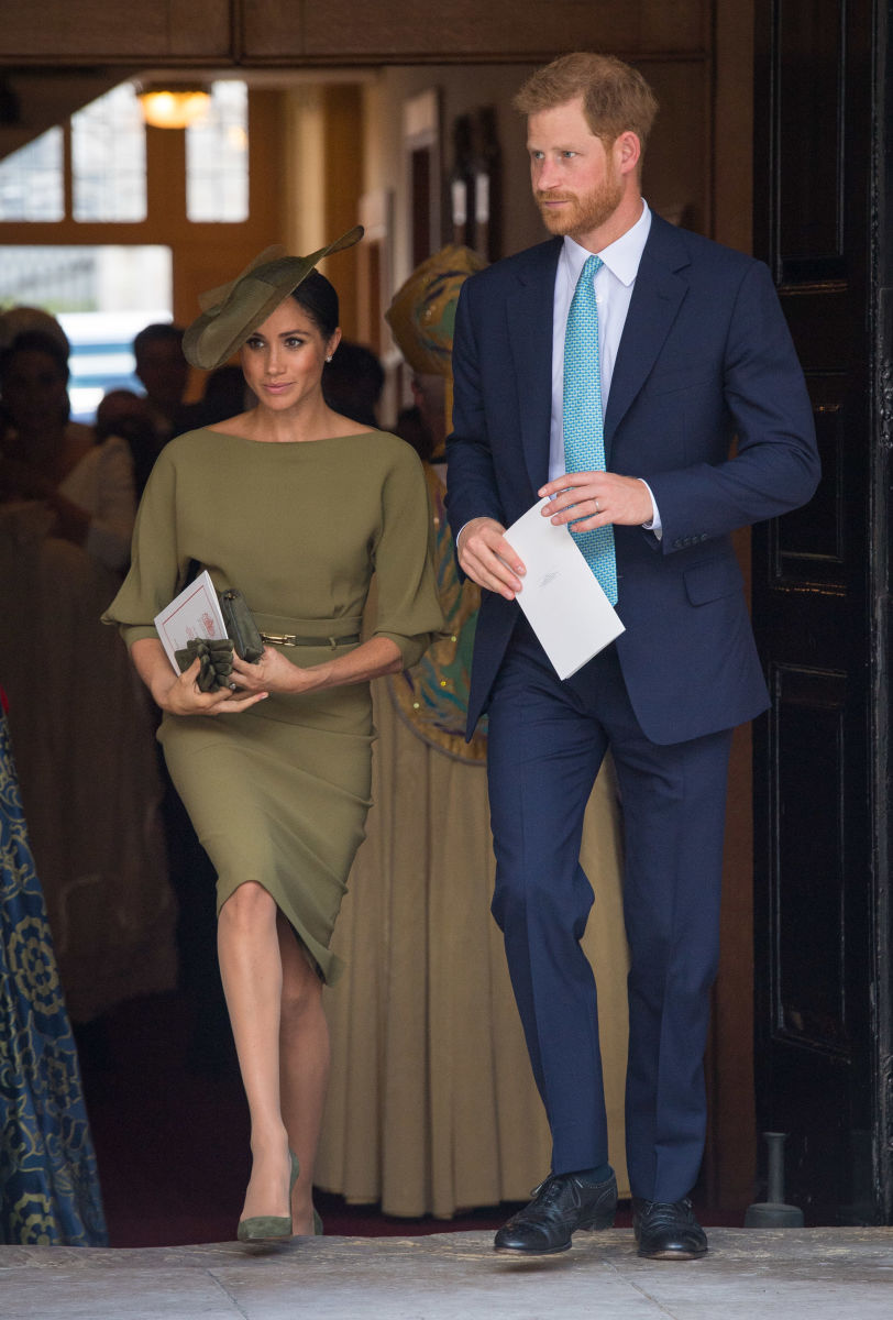 The Duchess of Sussex in a Ralph Lauren dress, Stephen Jones hat and Manolo Blahnik shoes with the Duke of Sussex. Photo:  Dominic Lipinski - WPA Pool/Getty Images
