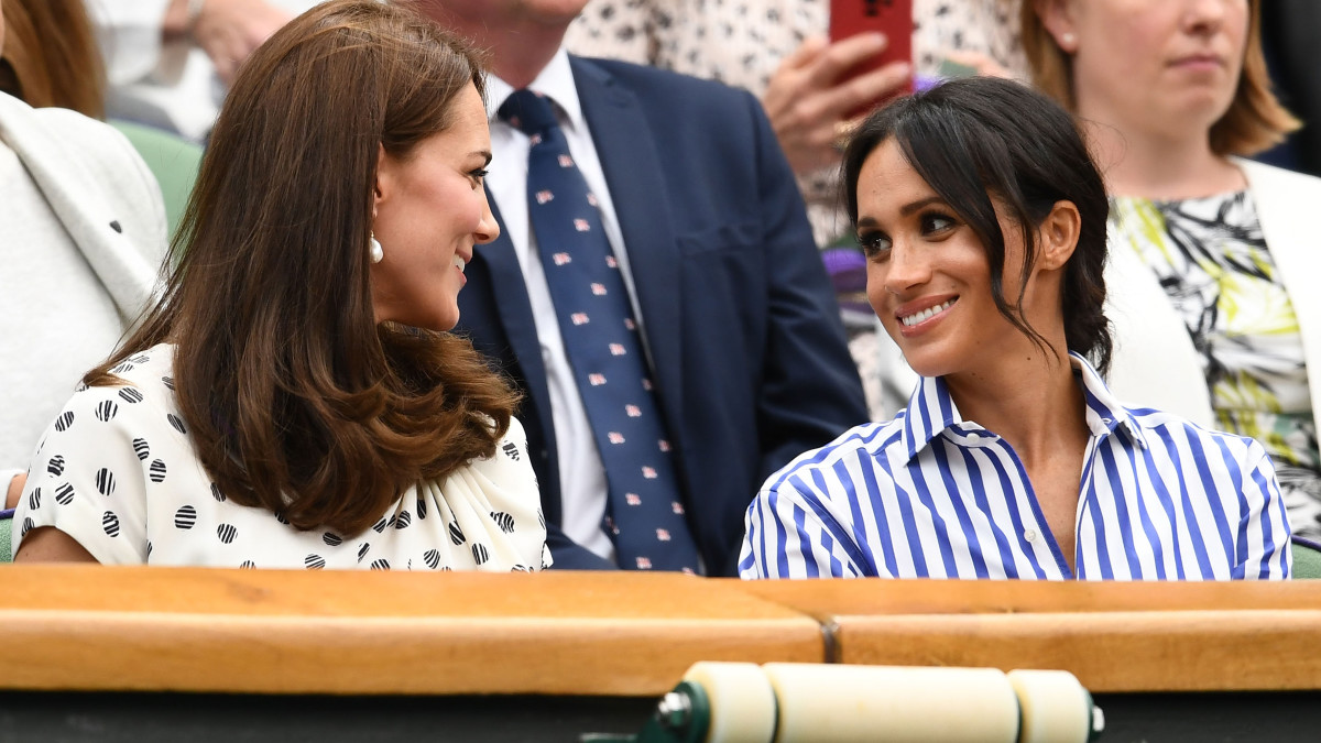 Catherine, Duchess of Cambridge, and Meghan, Duchess of Sussex, at Wimbledon in London. Photo: Clive Mason/Getty Images