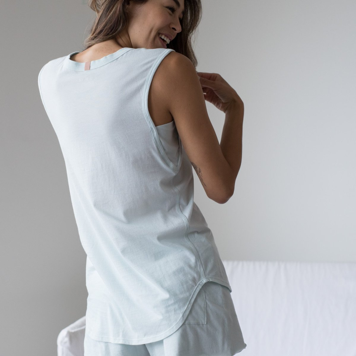 Lunya Cool Muscle Tee in Brisk, $68, available here; Lunya Cool Short in Brisk, $78, available here.