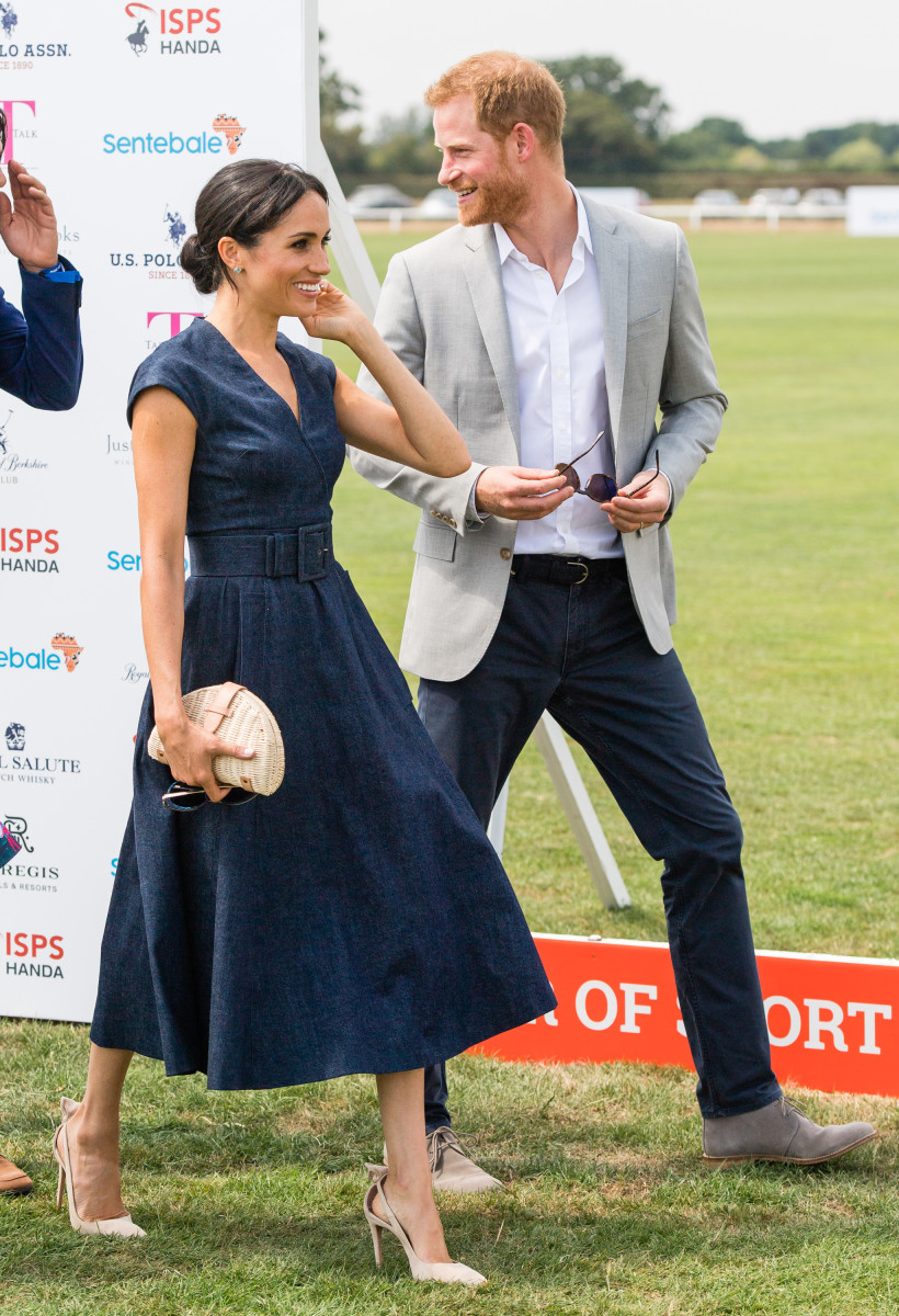 Duchess of Sussex Meghan Markle in Carolina Herrera with Duke of Sussex Prince Harry during the 2018 Sentebale polo match on Thursday in Windsor, England. Photo: Samir Hussein/Samir Hussein/WireImage