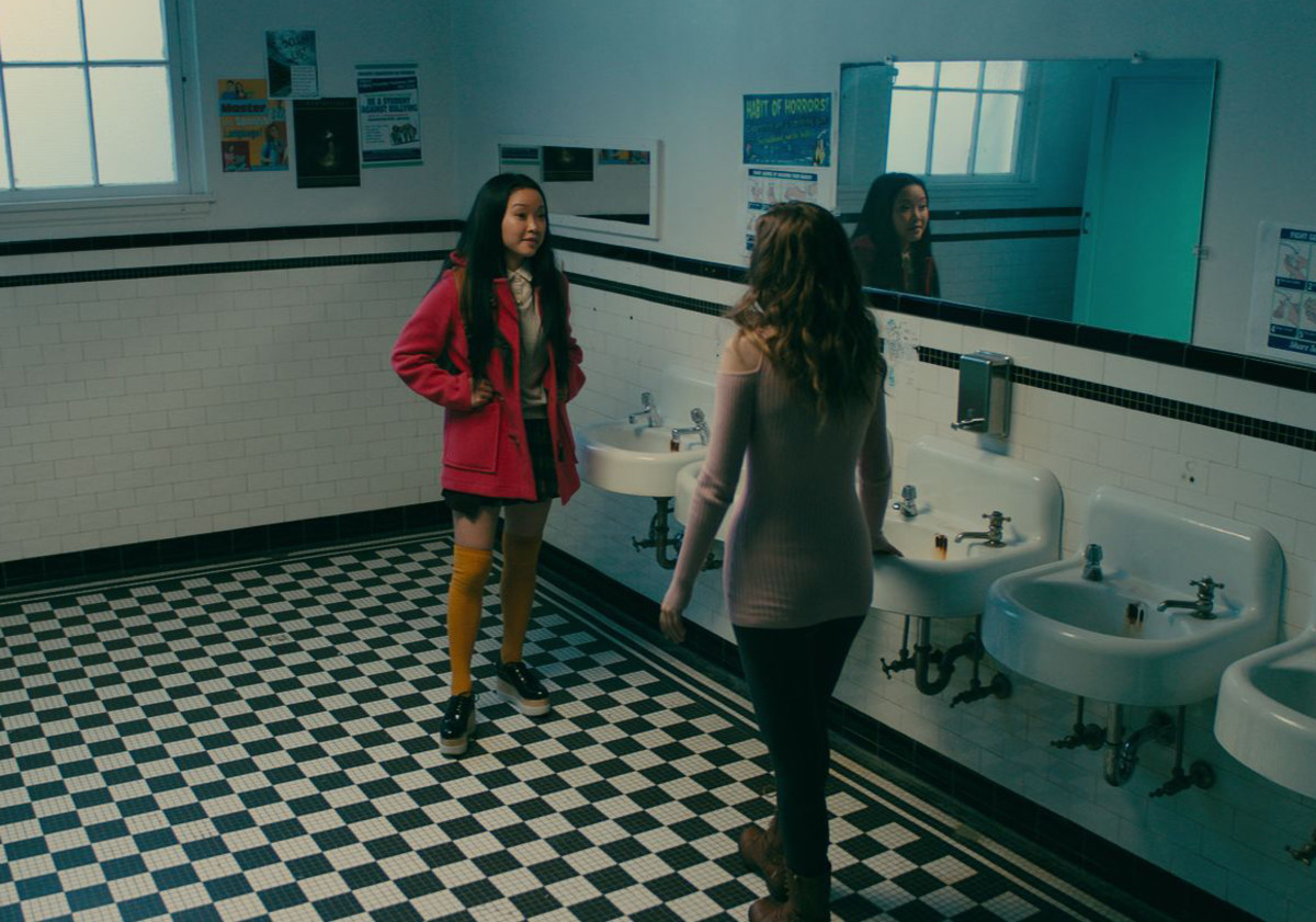 Lara Jean in her pink coat and Genevieve in her Ugg boots. Photo: Awesomeness Films