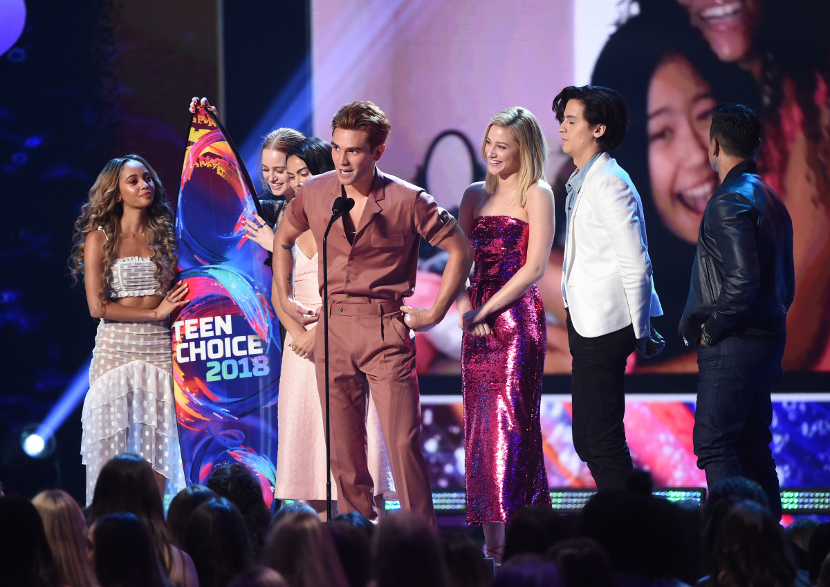 """Vanessa Morgan, Madelaine Petsch, Camila Mendes, KJ Apa, Lili Reinhart, Cole Sprouse and Mark Consuelos of """"Riverdale'"""" at the 2018 Teen Choice Awards. Photo: Kevin Winter/Getty Images"""