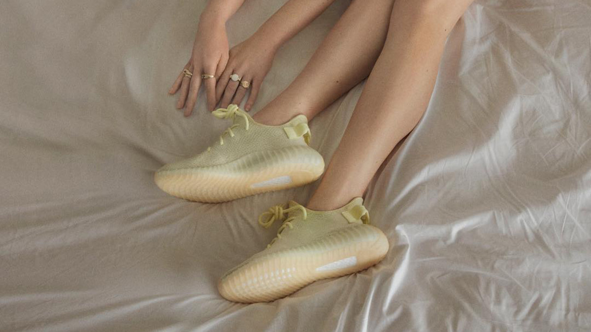 f1878a540a75 The New Yeezy Campaign Involves Wearing Sneakers on the Bed and I Hate That  - Fashionista