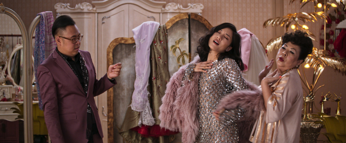 Oliver T'sien (Nico Santos) and Neenah Goh (Chieng Mun Koh) makeover — and reject — Rachel in Michael Kors. Photo: Courtesy of Warner Bros. Pictures