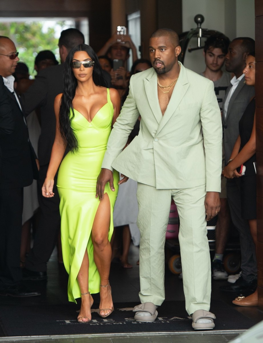 Kim Kardashian in slime green and Kanye West in Louis Vuitton at 2 Chainz's wedding. Photo: Courtesy of Louis Vuitton