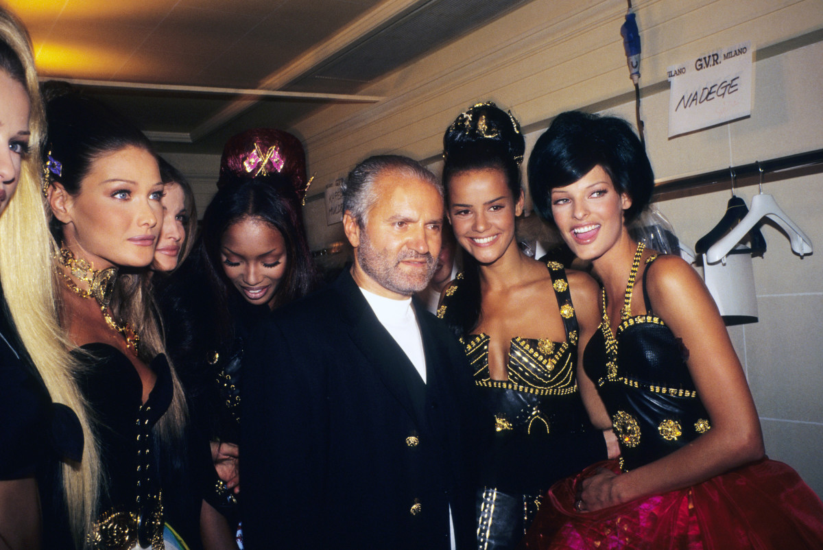 Carla Bruni, Naomi Campbell, Gianni Versace, Nadège du Bospertus and Linda Evangelista attend Gianni Versace Atelier's Fall 1992 show at the Ritz Hotel in Paris. Photo: Foc Kan/Wireimage