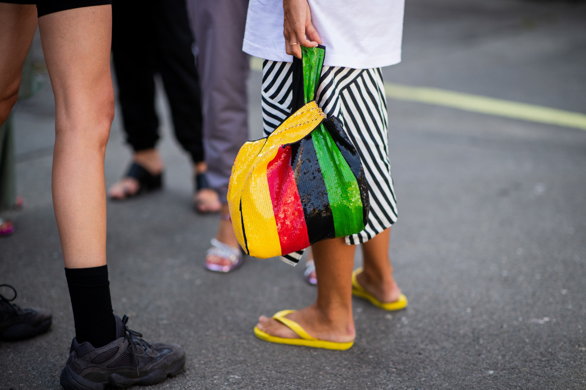 A Copenhagen Fashion Week show-goer wearing flip-flops. Photo: Christian Vierig/Getty Images