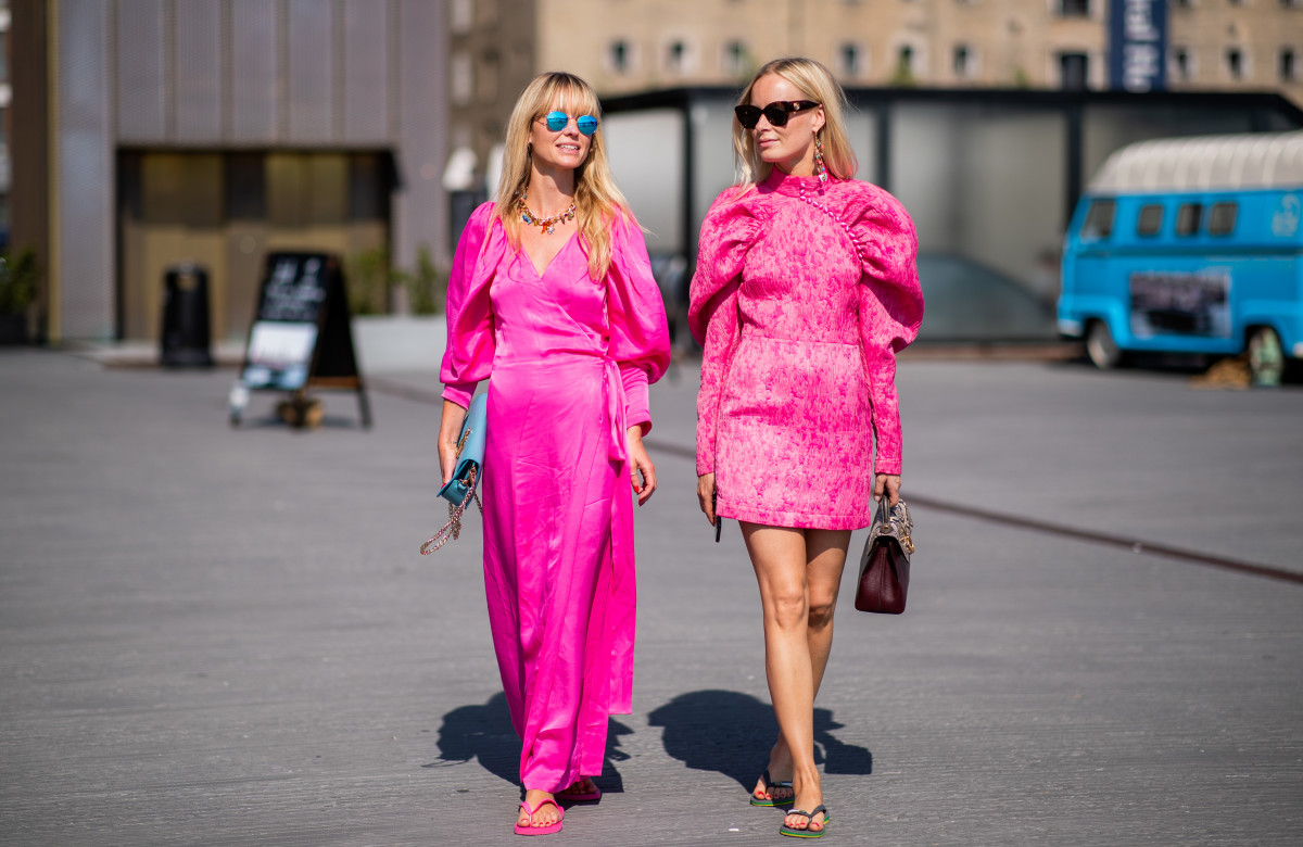 Jeannette Madsen and Thora Valdimars wearing flip-flops during Copenhagen Fashion Week. Photo: Christian Vierig/Getty Images