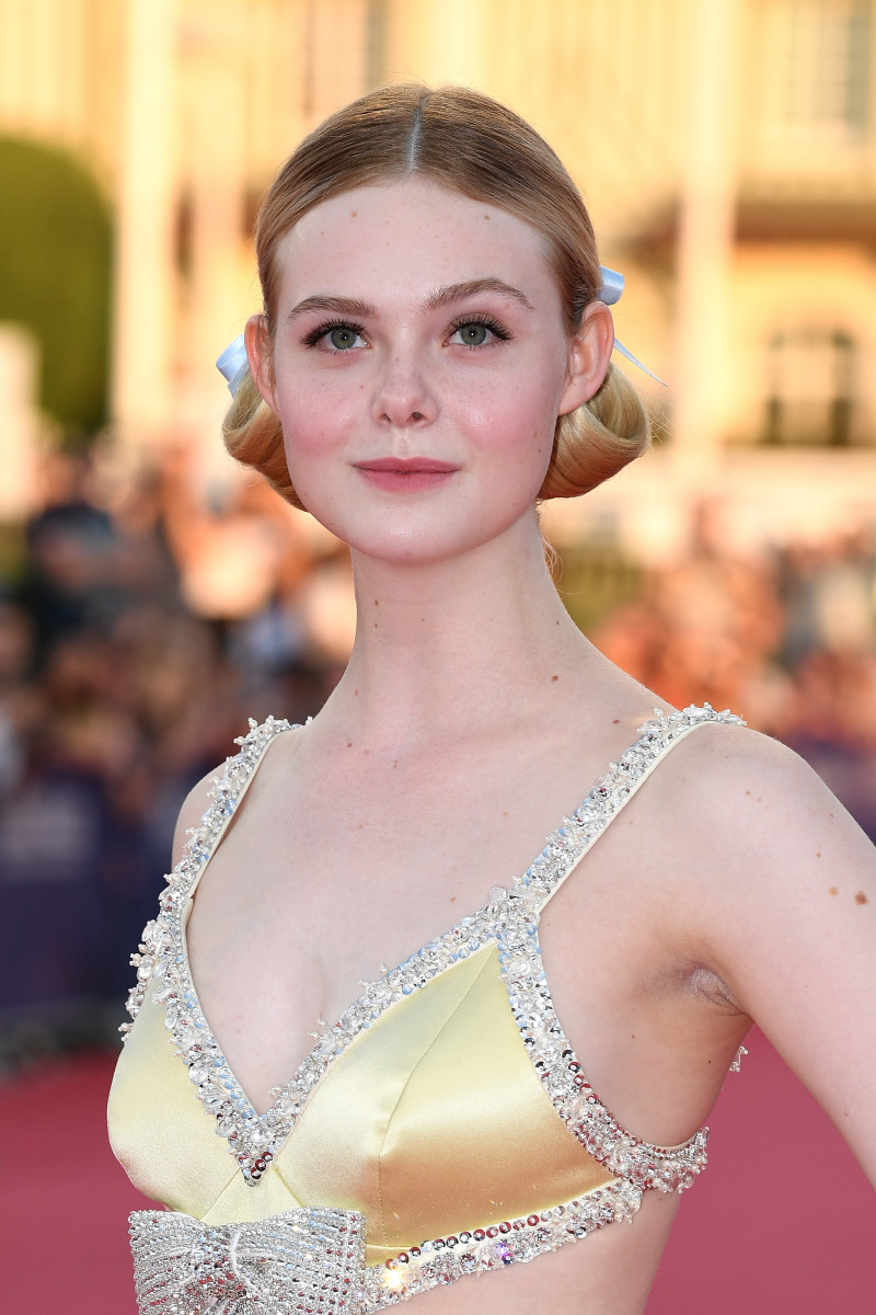 "Fanning wearing ""evening"" pigtails at the ""Galveston"" premiere during the Deauville Film Festival. Photo: Pascal Le Segretain/Getty Images"