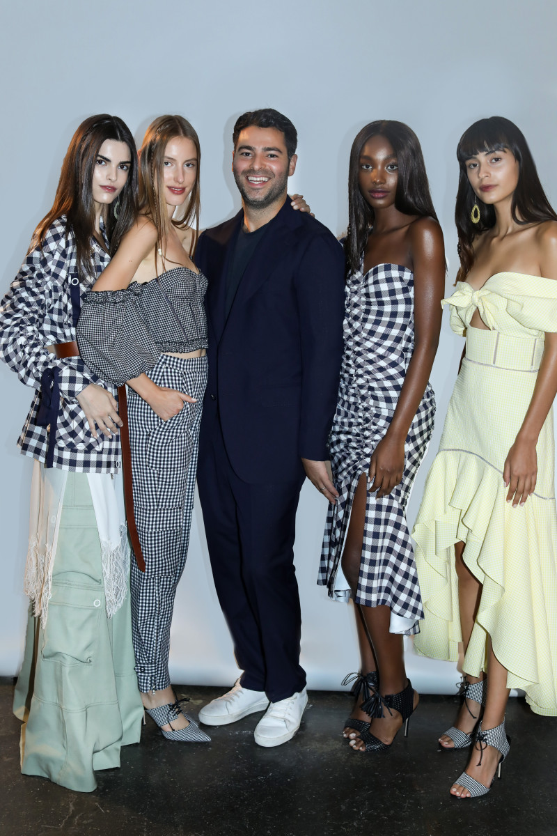 Jonathan Simkhai with models in looks from his Spring 2019 collection. Photo: Lee Oliviera