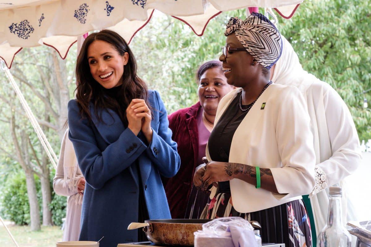 Meghan Markle with women of the Hubb Community Kitchen. Photo: @KensingtonRoyal/Twitter