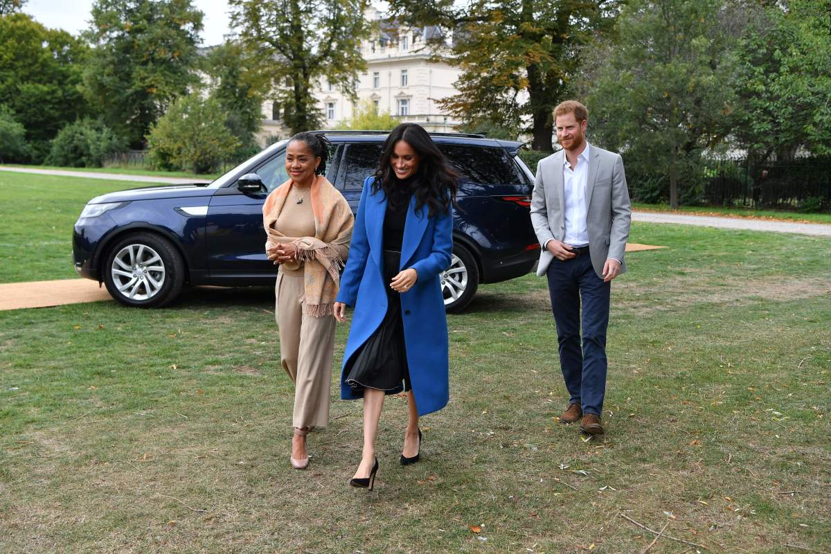 Meghan Markle with her mom, Doria Ragland, and Prince Harry. Photo: Ben Stansall/AFP/Getty Images
