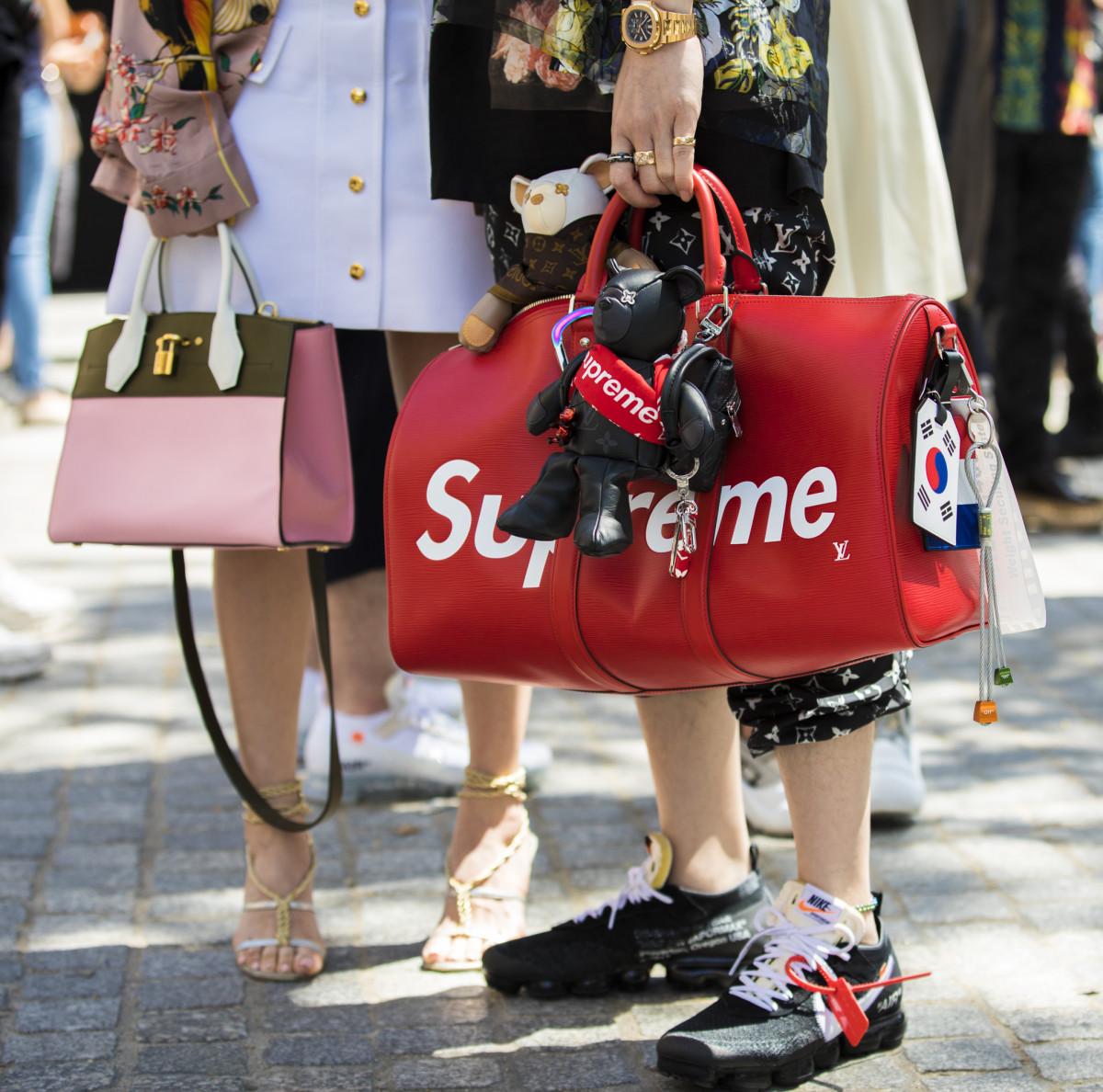 A Supreme x Louis Vuitton bag in Paris. Photo: Claudio Lavenia/Getty Images