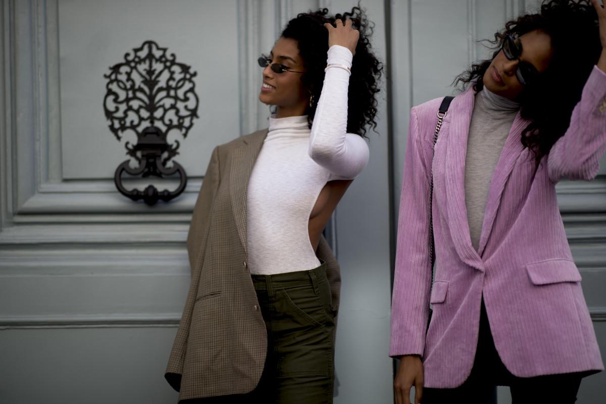 Models Imaan Hammam and Cindy Bruna on the street at Paris Fashion Week. Photo: Imaxtree