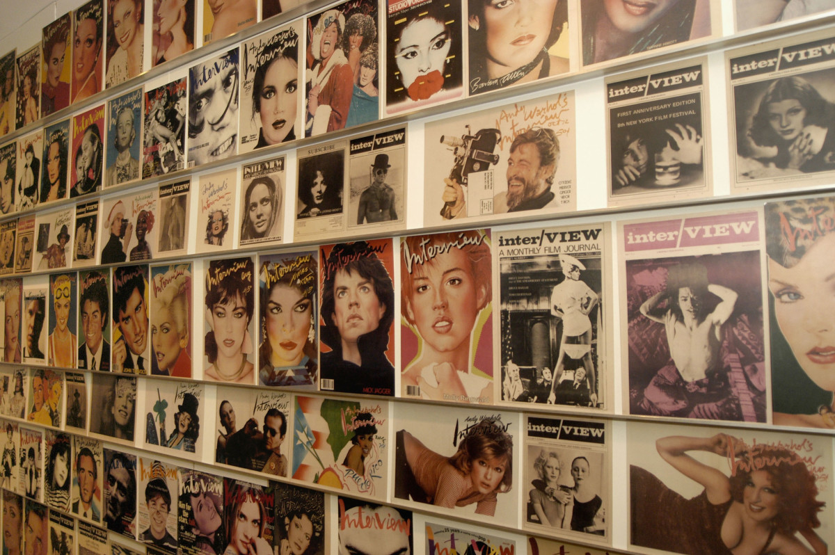 """A wall of """"Interview"""" magazine covers at The Andy Warhol Museum in Pittsburgh. Photo: Archie Carpenter/Getty Images"""