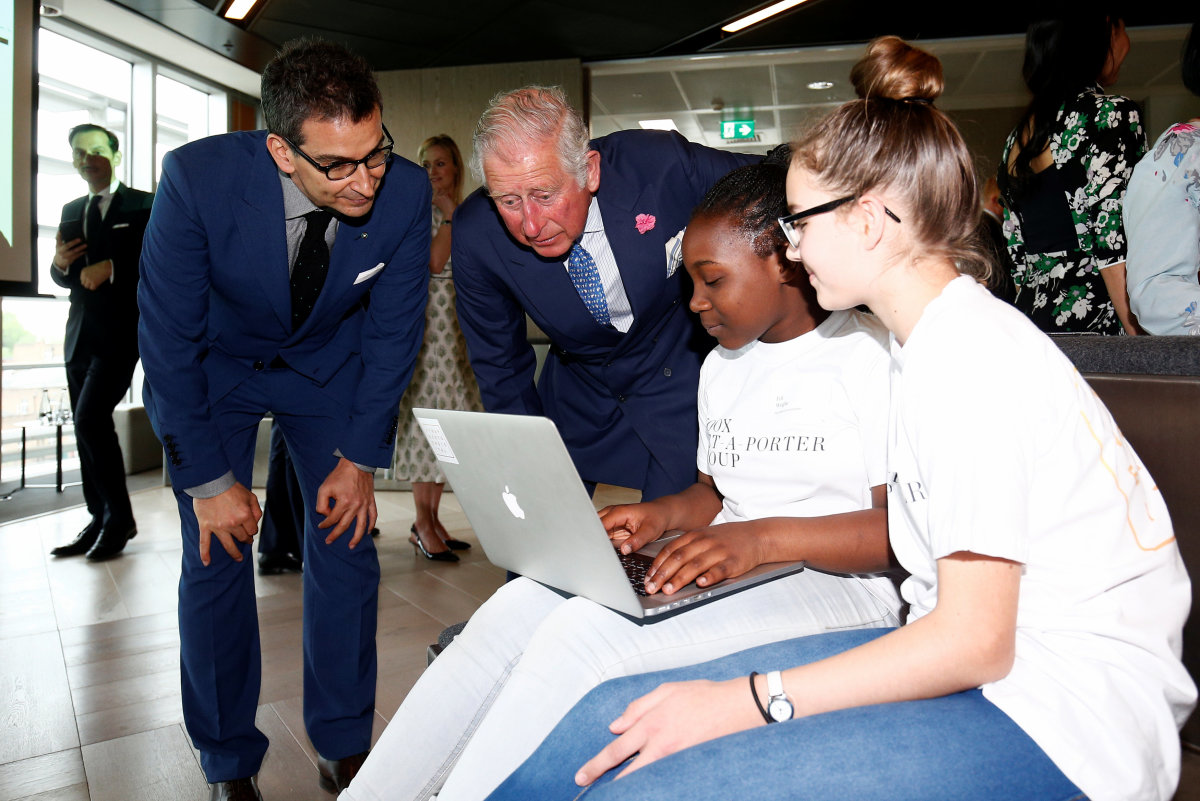 Prince Charles the new Yoox Net-a-Porter Group offices, with Yoox Net-a-Porter Group CEO Federico Marchetti in London. Photo: Henry Nicholls — WPA Pool/Getty Images