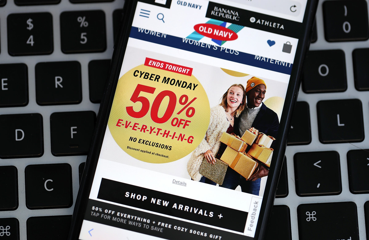 In this photo illustration, a Cyber Monday ad for Old Navy. Photo Illustration: Justin Sullivan/Getty Images