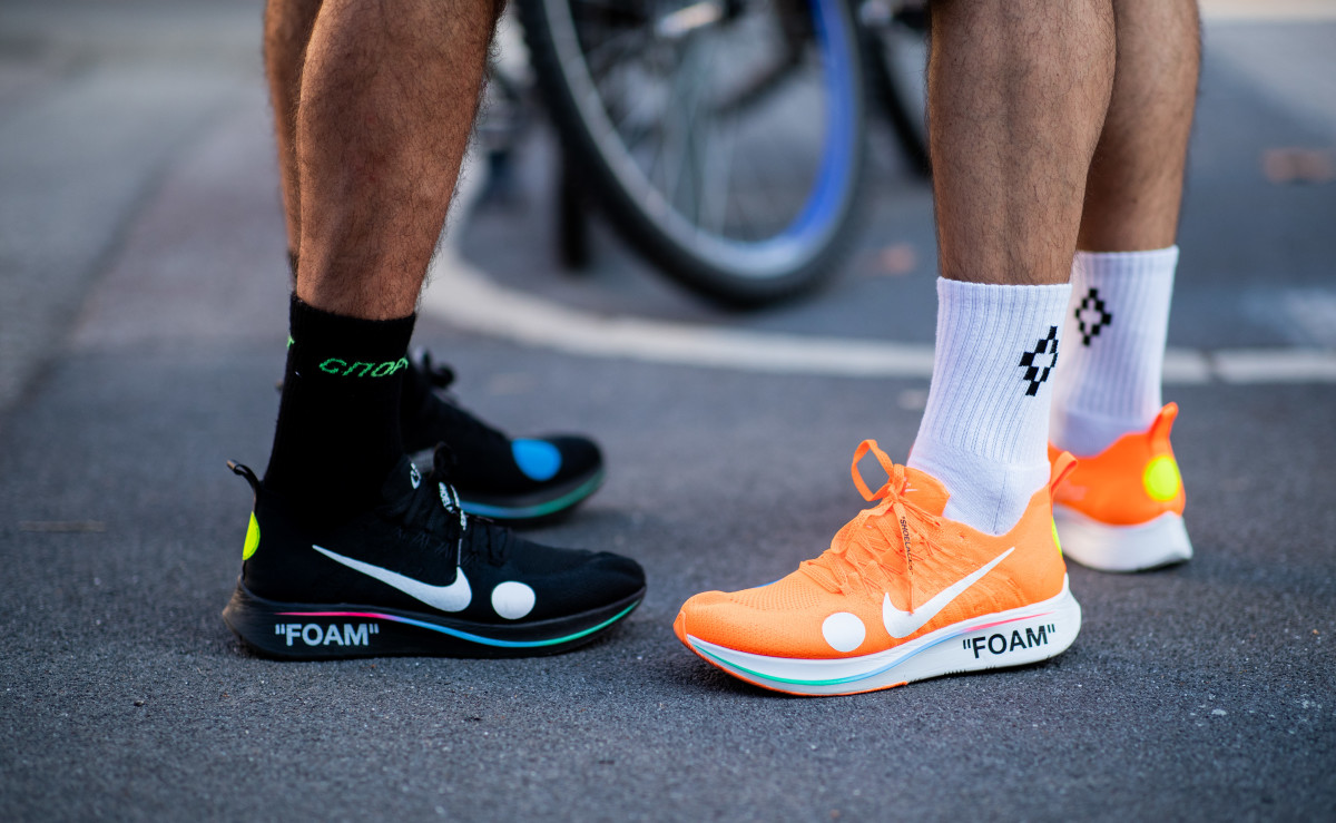 Showgoers wearing Off-White x Nike Foam sneakers during Milan Men's Fashion Week. Photo: Christian Vierig/Getty Images