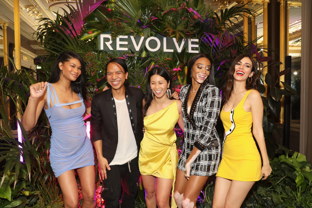"Chanel Iman, Michael Mente, Raissa Gerona, Winnie Harlow and Victoria Justice at Revolve's ""LA Party In London."" Photo: David M. Benett/Getty Images for Revolve"