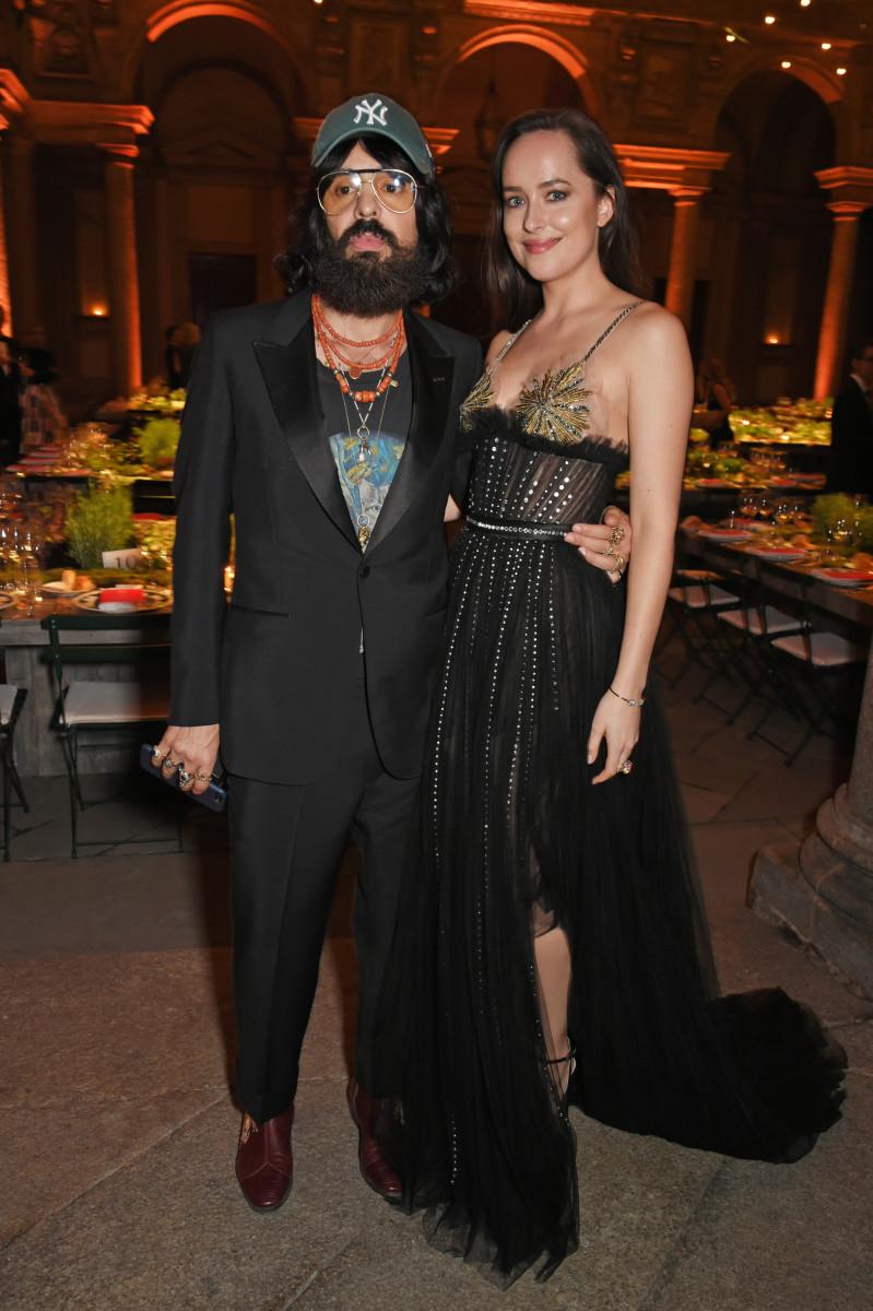 Alessandro Michele and Dakota Johnson in Gucci. Photo: Dave Benett/Getty Images