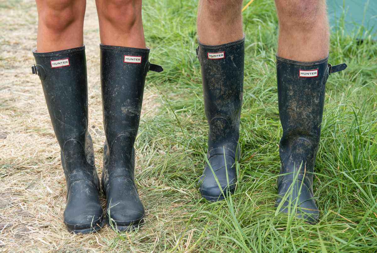 Festival-goers wear Hunter boots during the Glastonbury Festival. Photo: Ian Gavan/Getty Images