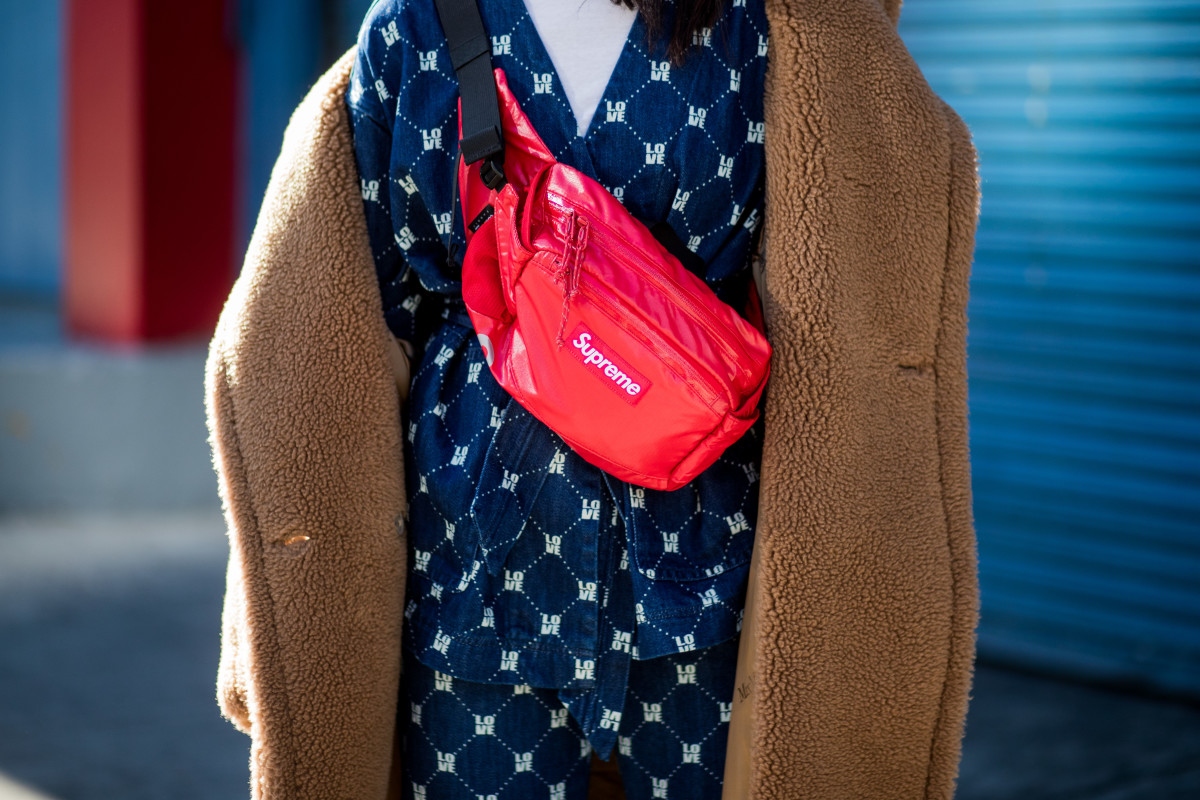 A New York Fashion Week showgoer wearing a Supreme x Louis Vuitton belt bag. Photo: Christian Vierig/Getty Images