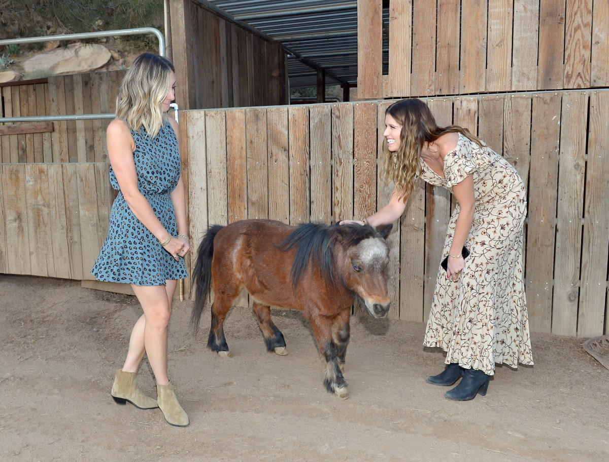 Emily Schuman and Katherine Schwarzenegger welcome a dinner guest.Photo: Courtesy of Fossil/Donato Sardella/Getty Images for Fossil