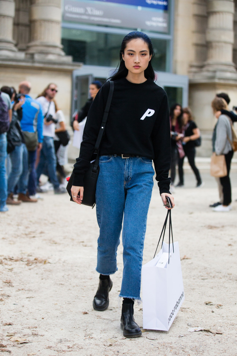Model Jing Wen in a Palace skateboards shirt outside of the Paco Rabanne show in Paris. Photo: Melodie Jeng/Getty Images