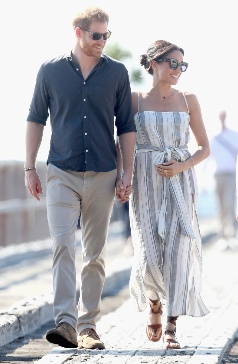 Prince Harry and Meghan Markle (in Reformation) walking along Kingfisher Bay Jetty in Fraser Island, Australia. Photo: Chris Jackson/Getty Images