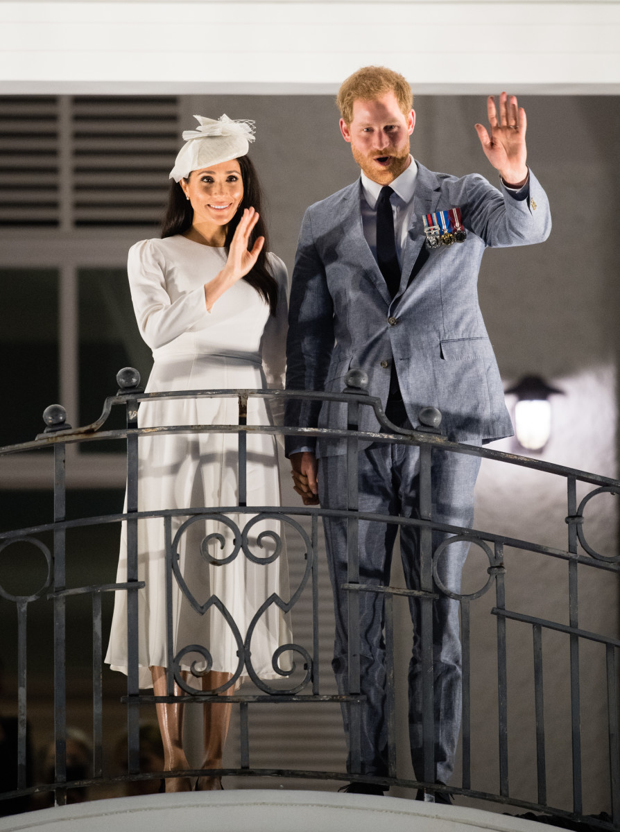 The Duke and Duchess of Sussex wave from the balcony of the Grand Pacific Hotel in Suva, Fiji on Tuesday. Photo: Samir Hussein/WireImage