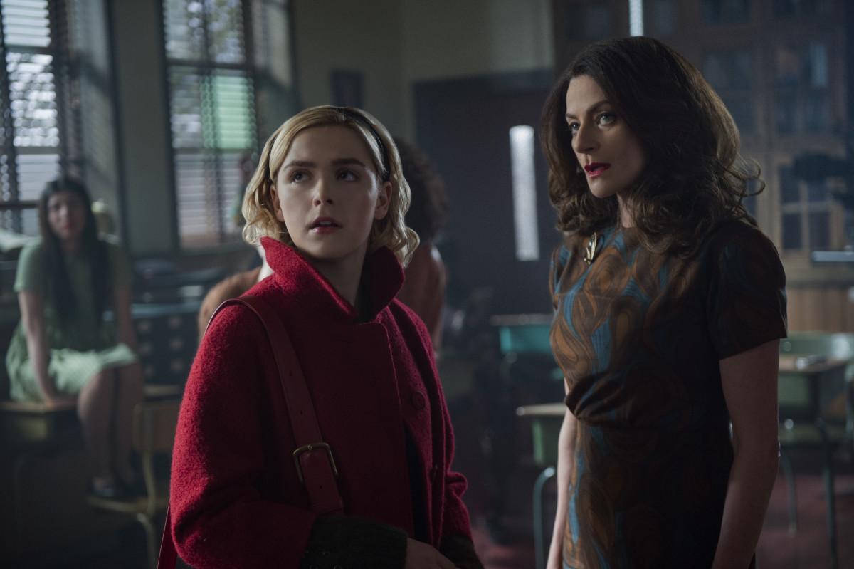 "Sabrina Spellman (Kiernan Shipka) and Miss Wardwell, post ""makeover"" with her Ann-Margret-inspired voluminous hair. Photo:Diyah Pera/Courtesy of Netflix"