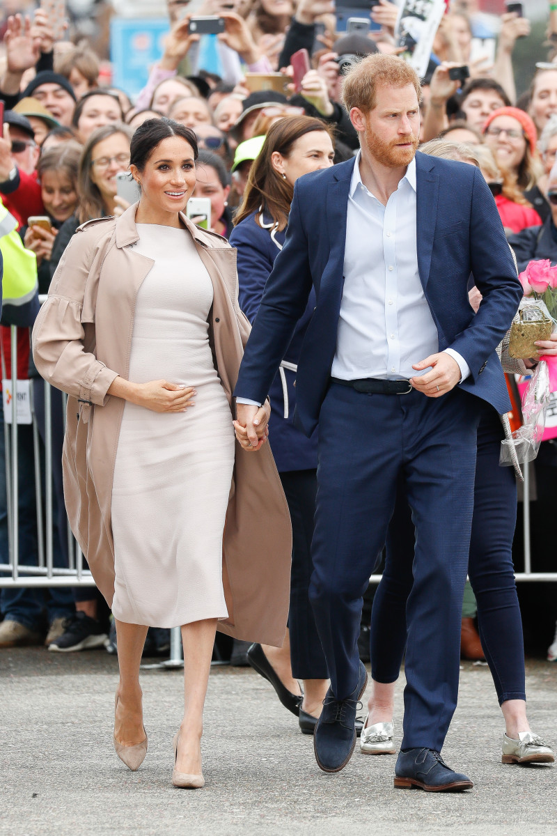 """Meghan Markle (in Brandon Maxwell) and Prince Harry during a """"walkabout"""" in Auckland, New Zealand. Photo: Chris Jackson/Getty Images"""