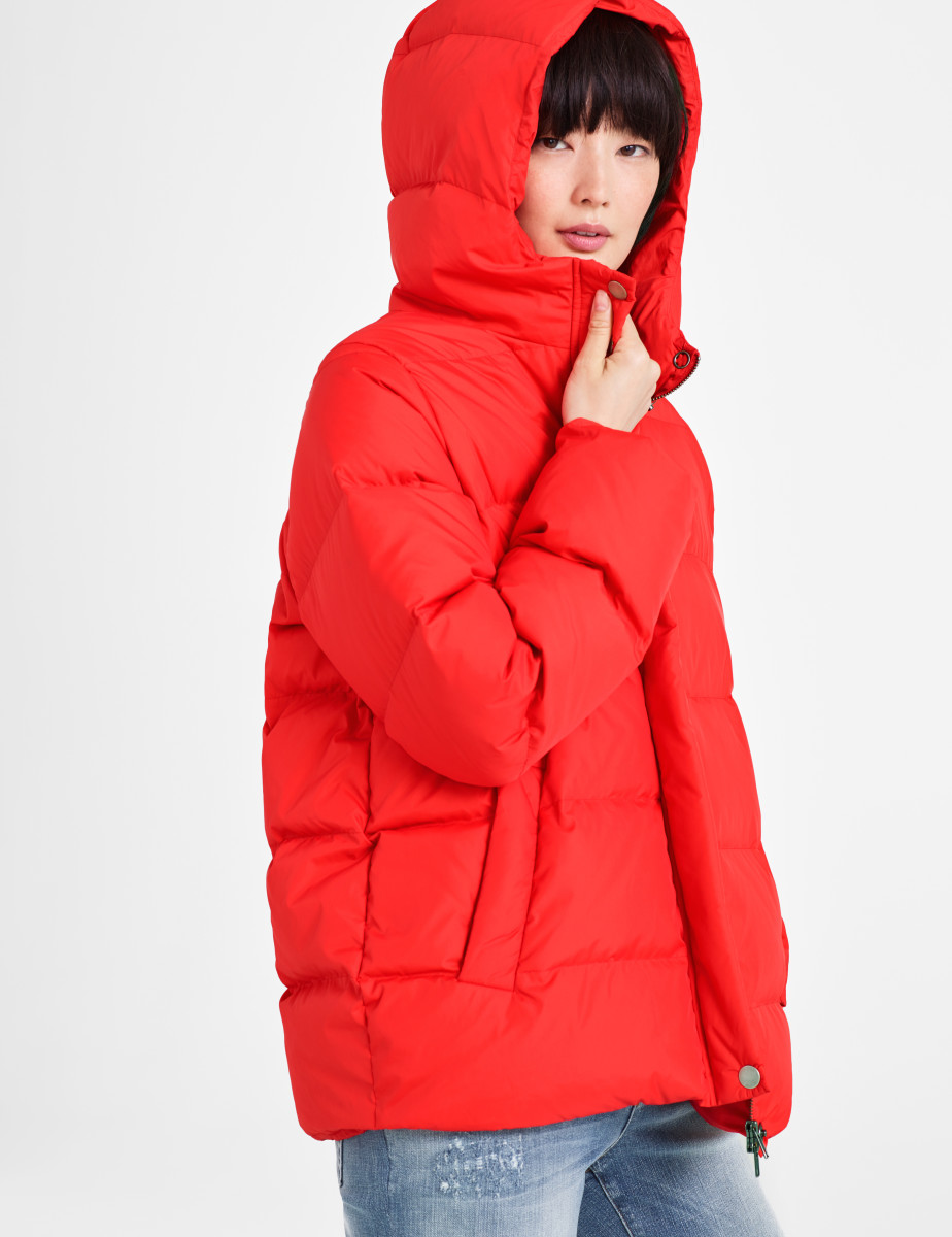 "Eileen Fisher's Recycled Nylon Down Jacket in ""Red Lory""; recycled nylon can be repurposed from many forms of post-industrial or -consumer waste, most notably fishing nets. Photo: Eileen Fisher"