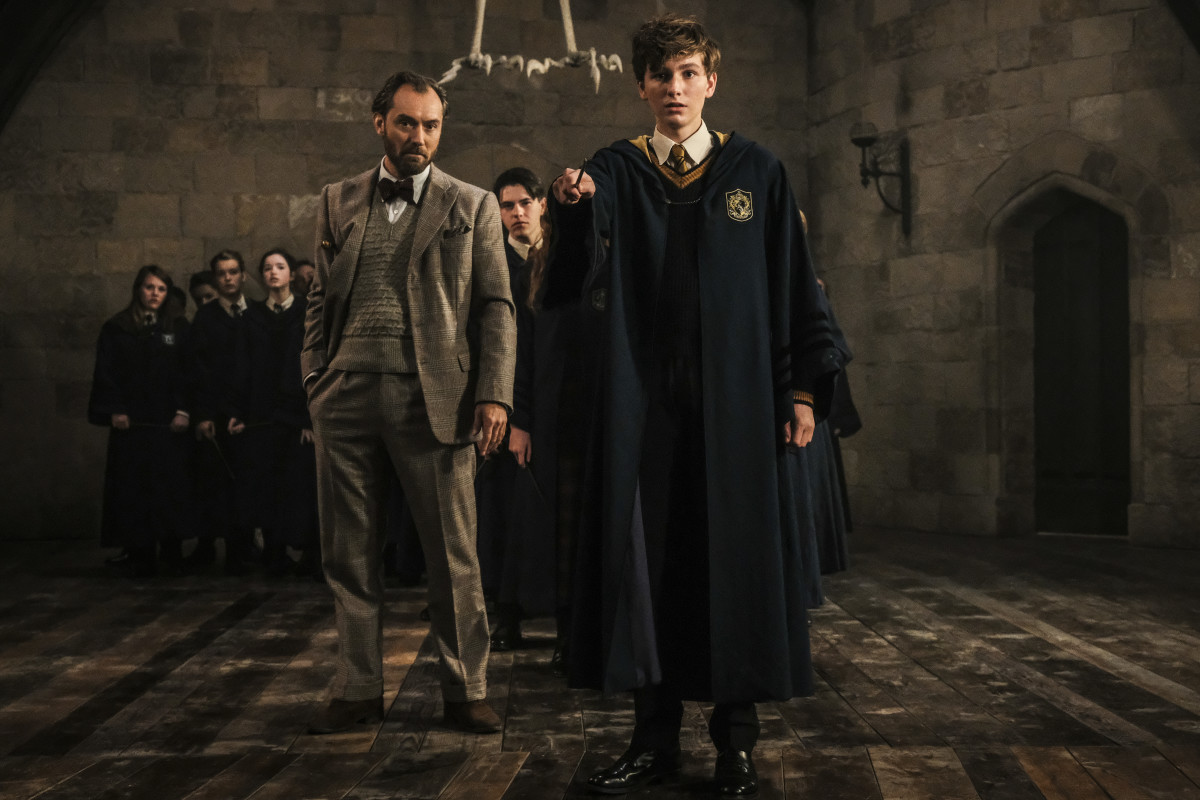 Tweedy Dumbledore and a young Newt (Joshua Shea) at Hogwarts. Jaap Buitendijk/Courtesy of Warner Bros. Pictures