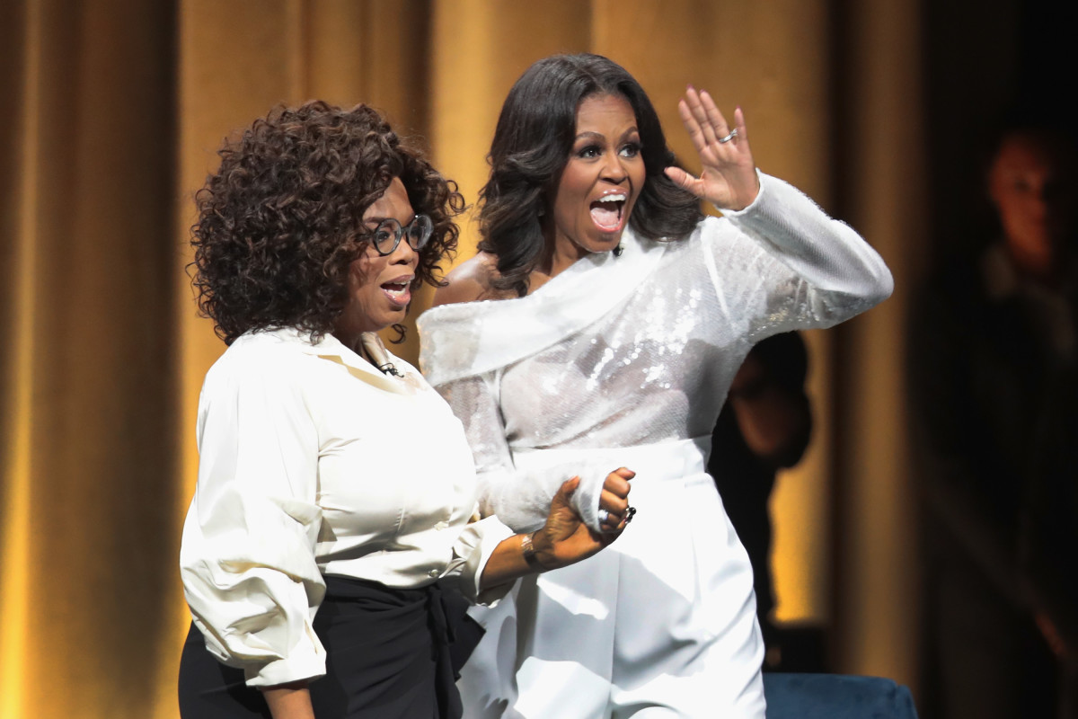 "Michelle Obama in Sally Lapointe with Oprah Winfrey as she kicks off her ""Becoming"" arena book tour on in Chicago, Illinois. Photo: Scott Olson/Getty Images"