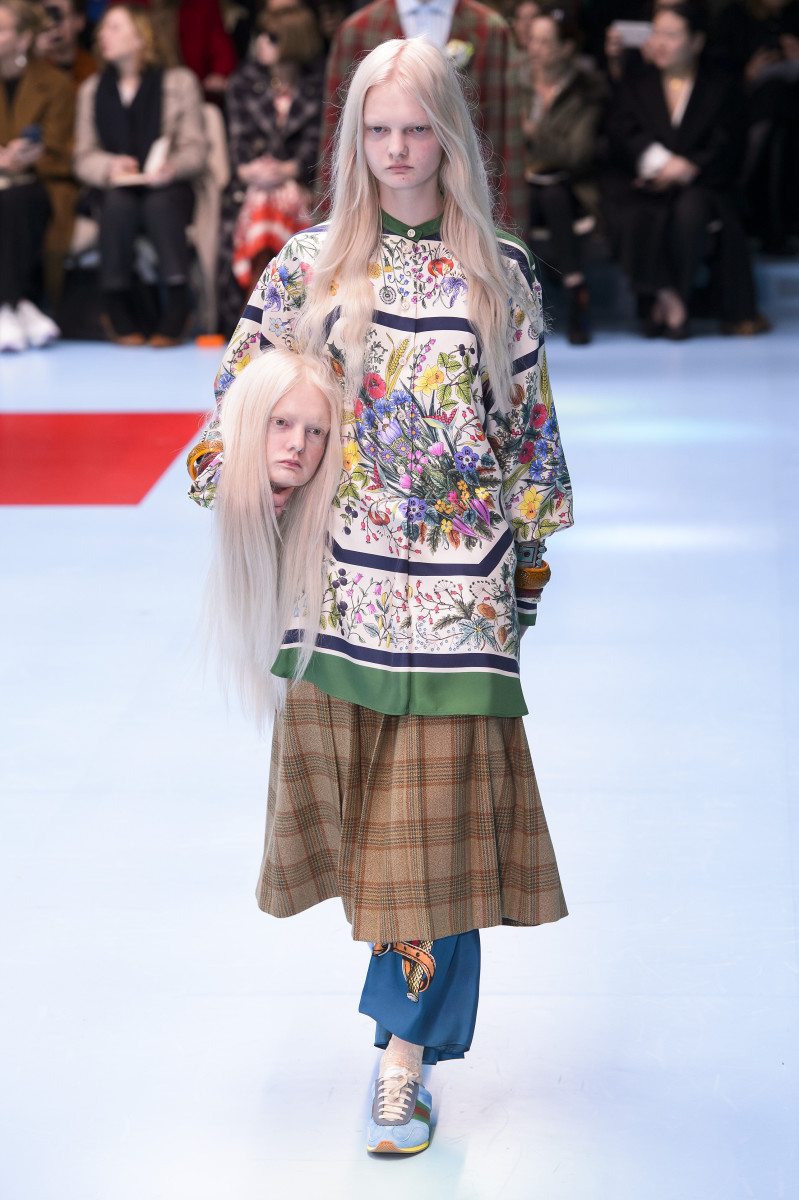 A model carries a replica of her own freaking head on the Gucci Fall 2018 runway. Photo: Imaxtree