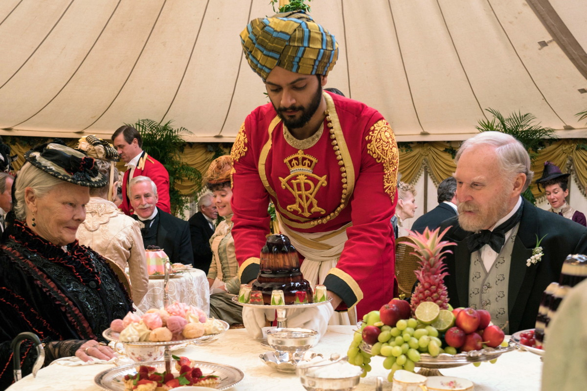 Queen Victoria (Judi Dench), Abdul Karim (Ali Fazal), a jello mold and Sir Henry Ponsonby (Tim Pigott-Smith) Photo: Peter Mountain / Focus Features
