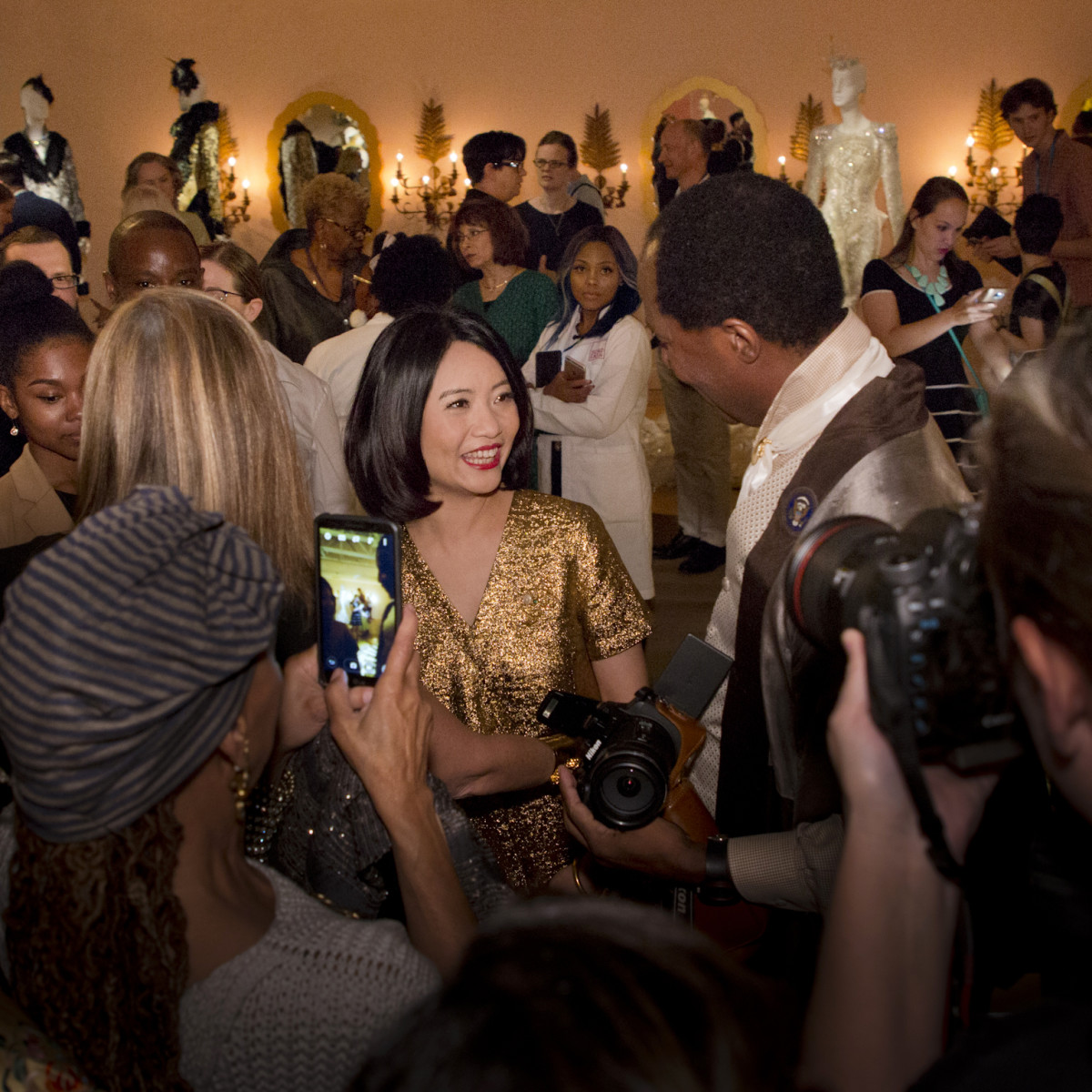 Couturier Guo Pei surrounded by fans at the opening reception of her first U.S. solo exhibition at SCAD FASH Museum of Fashion + Film. Photo: Courtesy of SCAD