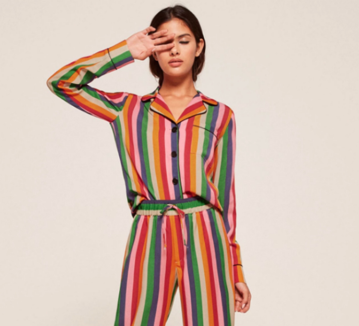 Reformation pajama set in rainbow stripe, $128, available at Reformation.