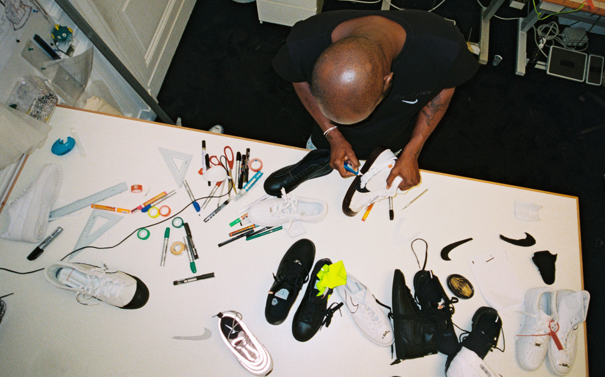 "Virgil Abloh designing ""The Ten"" for Nike. Photo: Nike"