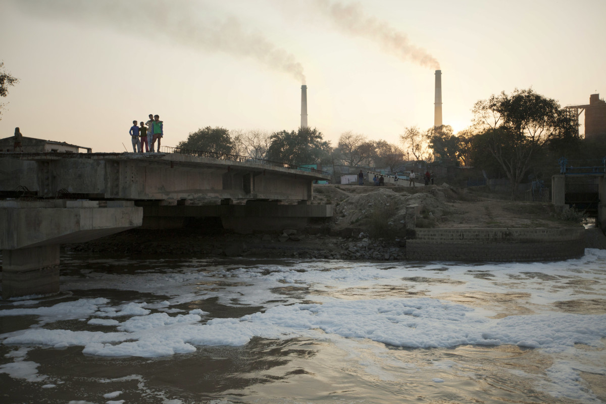 Chemical pollution floating atop a river. Photo: RiverBlue
