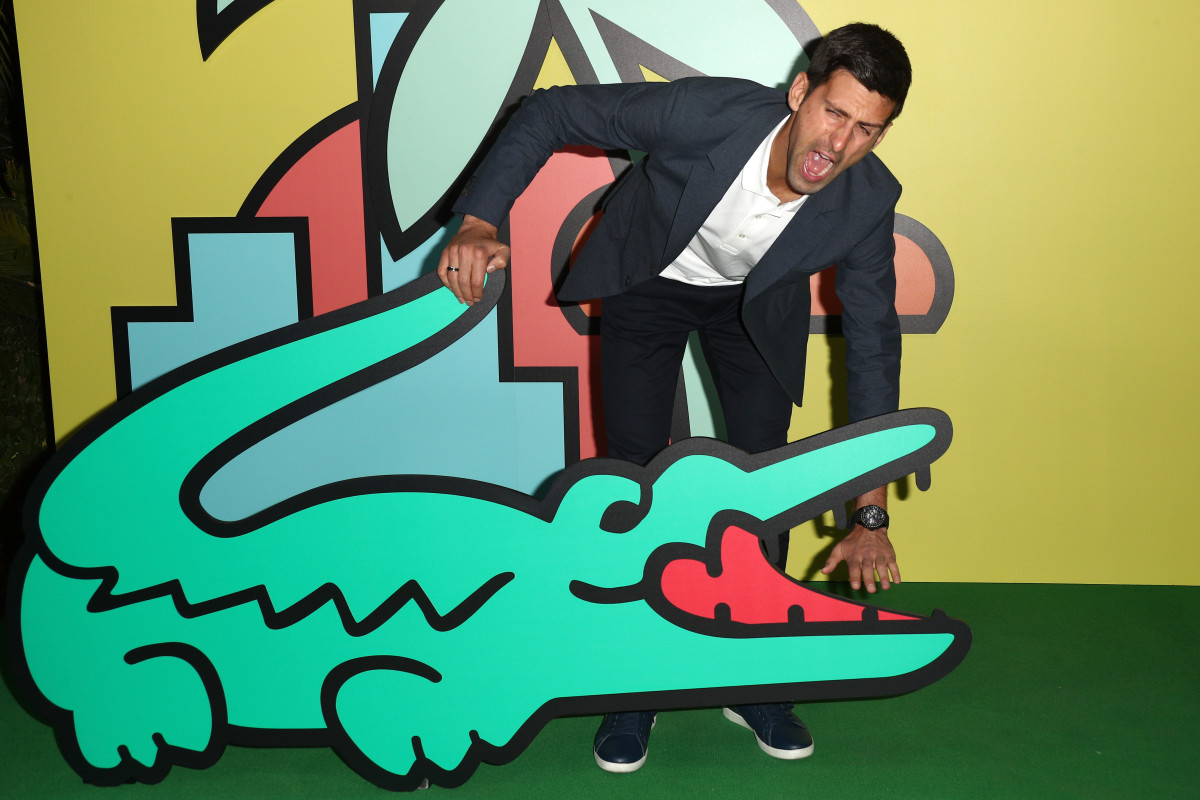 Novak Djokovic with a M/M Paris-designed cardboard crocodile at a party to celebrate the Beverly Hills store reopening in November. Photo: Frederick M. Brown/Getty Images