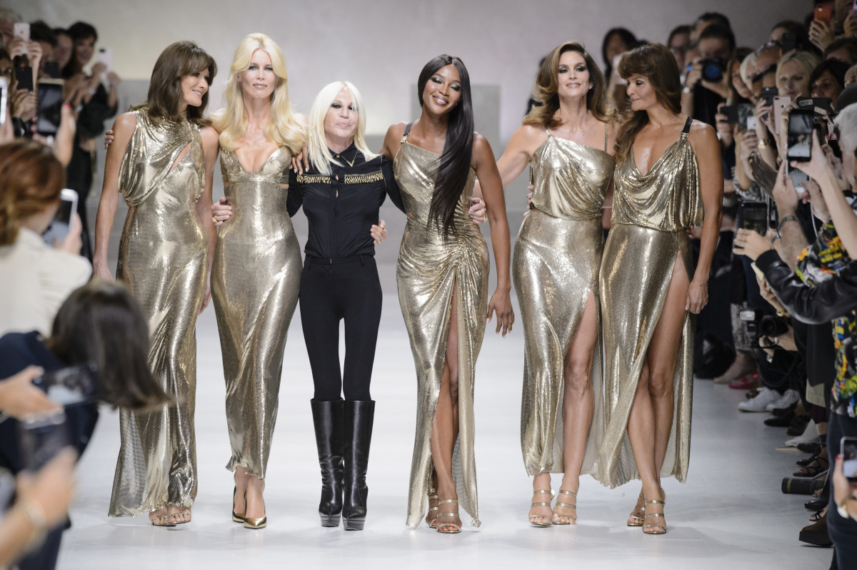 Donatella Versace walks with the original supers to close out Versace's Spring 2018 show. Photo: Imaxtree